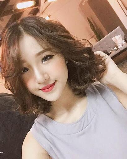 Co-gai-hien-dai-voi-mai-toc-ngan-uon-xoan-gon-song